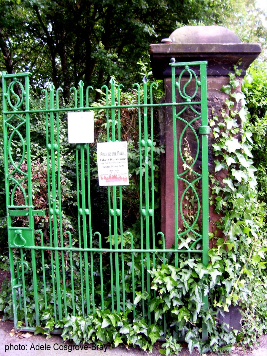 Encased in ivy, these iron gates are set into pillars carved from local red sandtone.