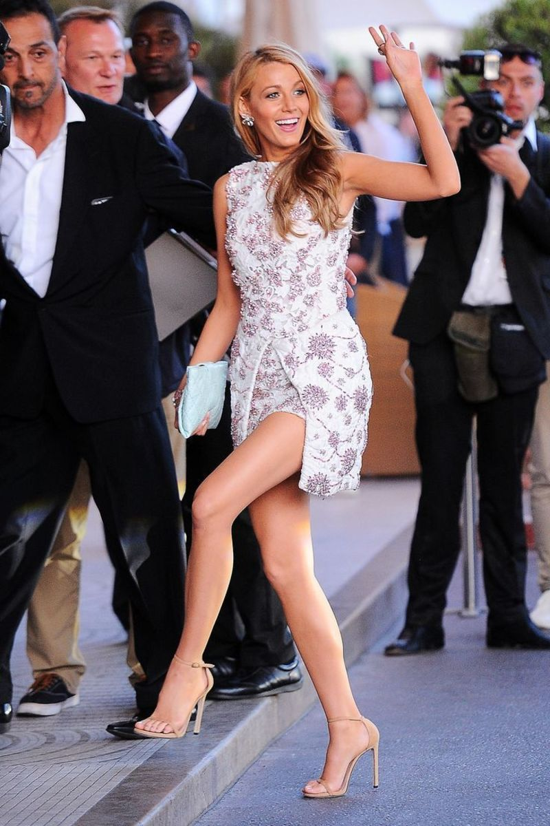 Leggy Blake Lively in a thigh high split spring dress and nude ankle strap high heels