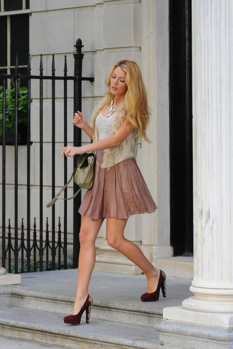 Blake Lively leaving her hotel in a short dress with studded high heels