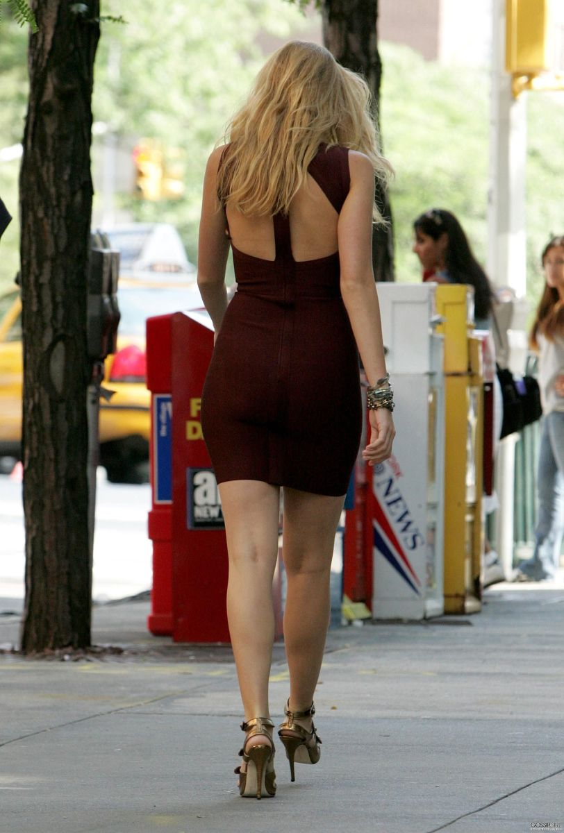 Blake Lively in a short and tight dress and strappy high heels