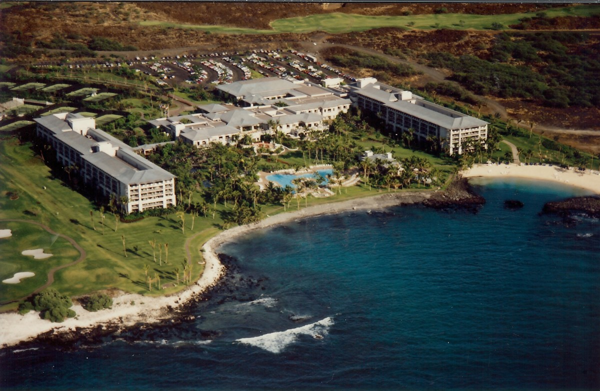 Note the resort surrounded by lava fields and the green strip of golf course behind the resort.