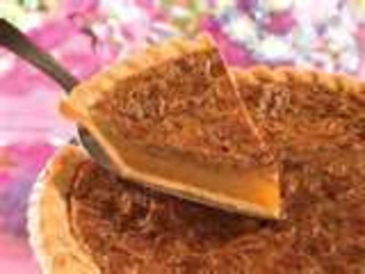 Mashed potato pie with pecans could tempt and trick just about anyone with an appetite.  I like icy whipped topping with coconut on it.