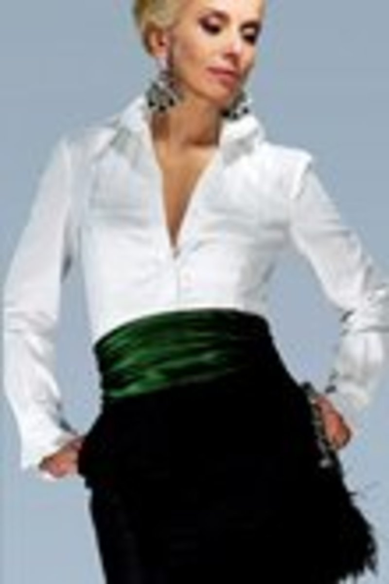 As featured on brides.com; photo credit brides.com;    designed by Charles Nolan;   White cotton tuxedo shirt   $178; black silk taffeta skirt $598; green taffeta sash $150    accessories: Swarovski crystal and jade CZ earrings $390 by Edict; feather