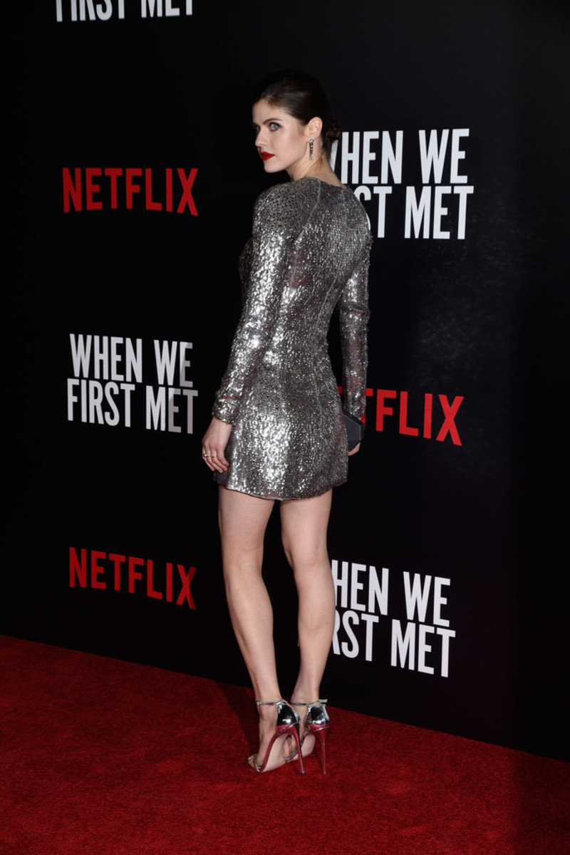 Alexandra Daddario sexy legs in a silver mini dress and matching ankle strap high heels on the red carpet in support of her Netflix movie