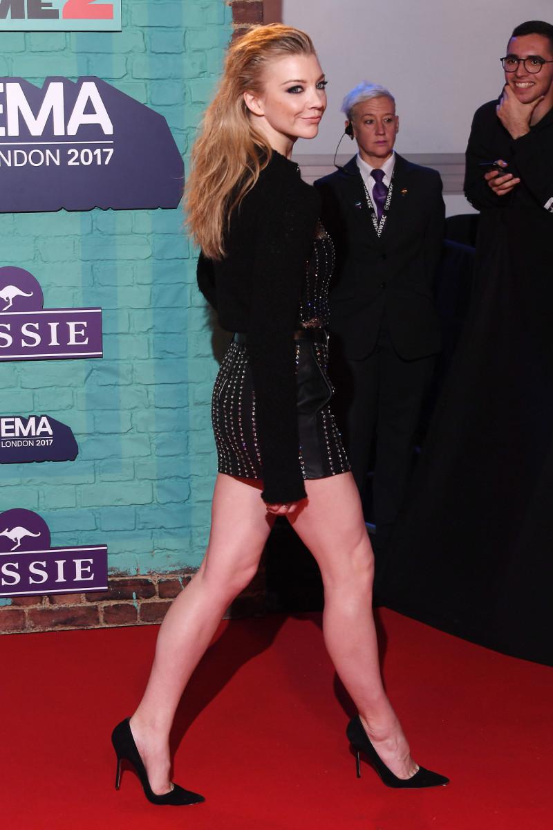 Natalie Dormer leggy in a long sleeved black mini dress with high heels