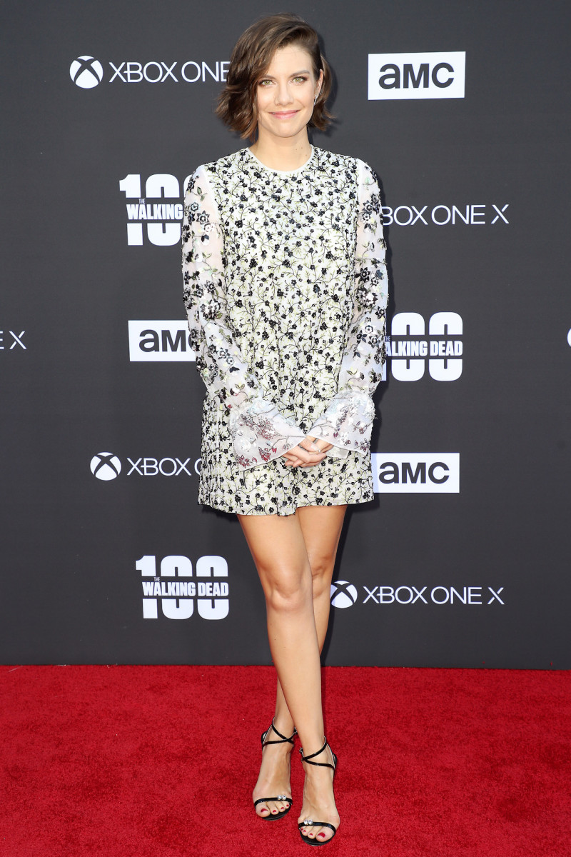 Lauren Cohan posing on the red carpet promoting The Walking Dead in a patterned mini dress with ankle strap high heels