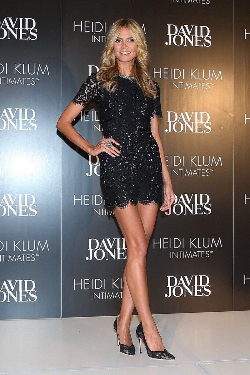 Heidi Klum endless legs in a short evening dress and high heels promoting her lingerie line
