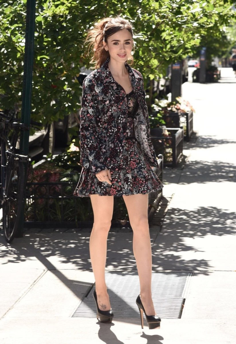 Lily Collins elegant street style in a floral mini dress and high heels