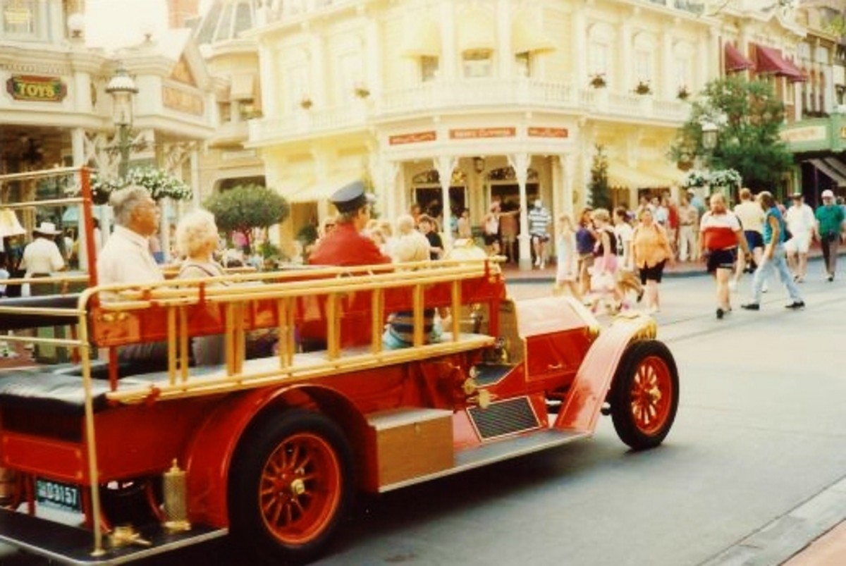 Red firetruck offering transportation in Main Street USA