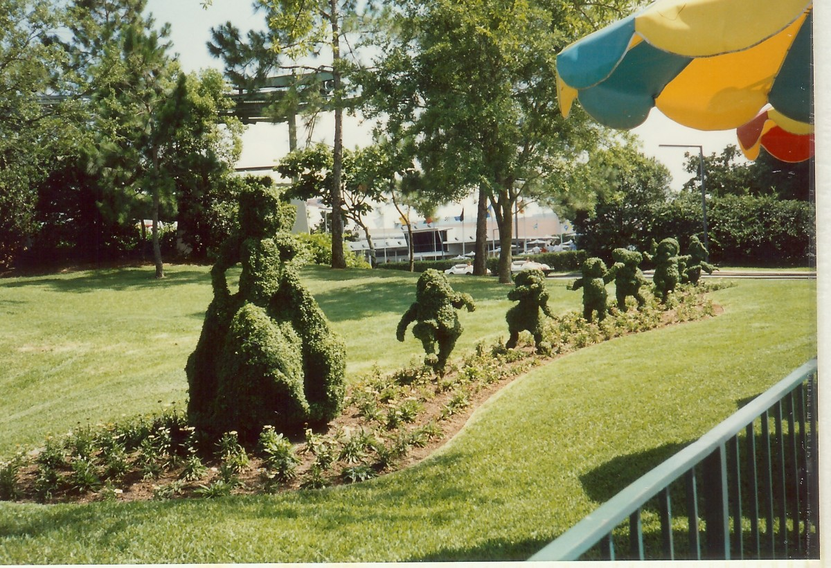 Great topiary in green spaces around Main Street USA