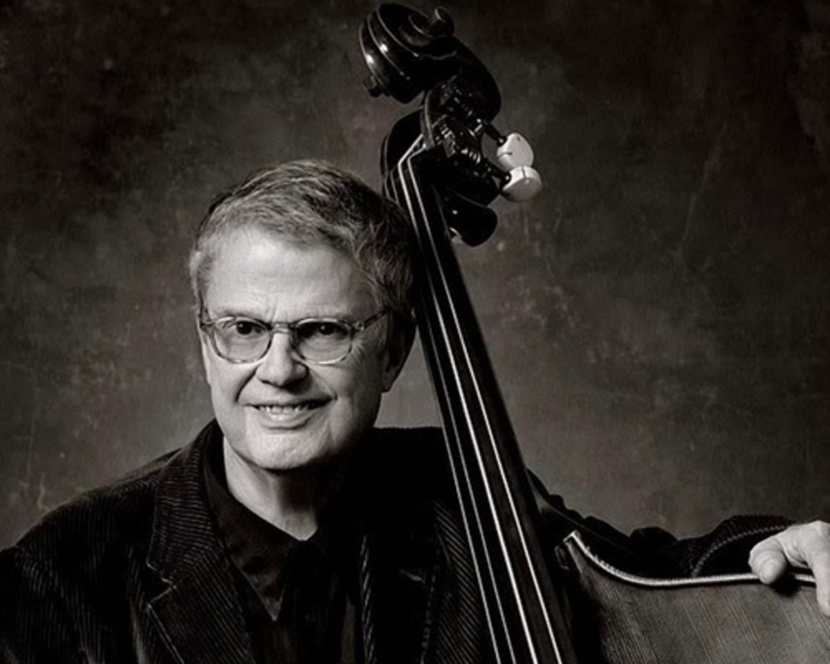Charlie Haden is on a square platform at the back of the Barbican's stage wearing an absurdly baggy suit, purple tie and trademark rimmed spectacles. It's the first gig of a two-night stint and tonight he's joined by Quartet West, a band formed in 19