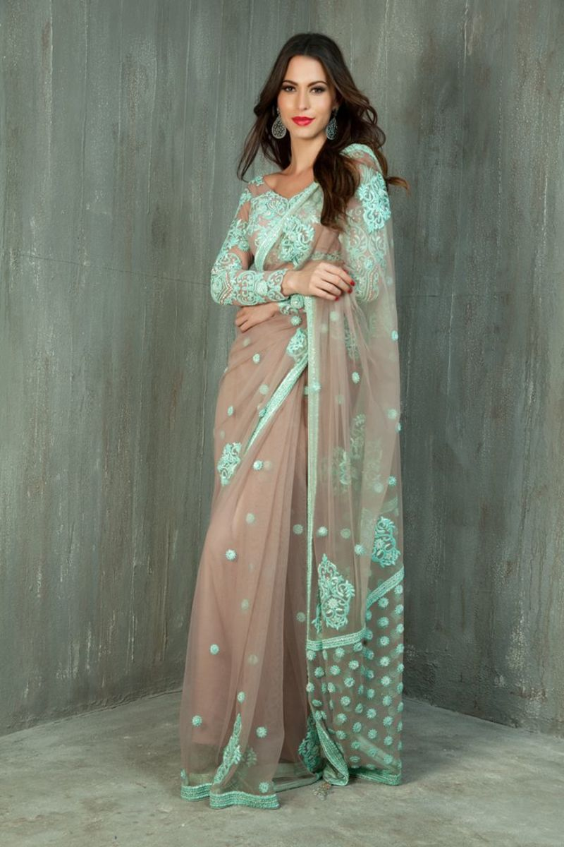 stunning nude saree with mint embroidery paired with heavy design full sleeve blouj