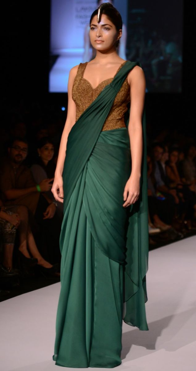 Bottle green Shammo Silk Saree with full length stomach covered saree blouse with all over bronze beads