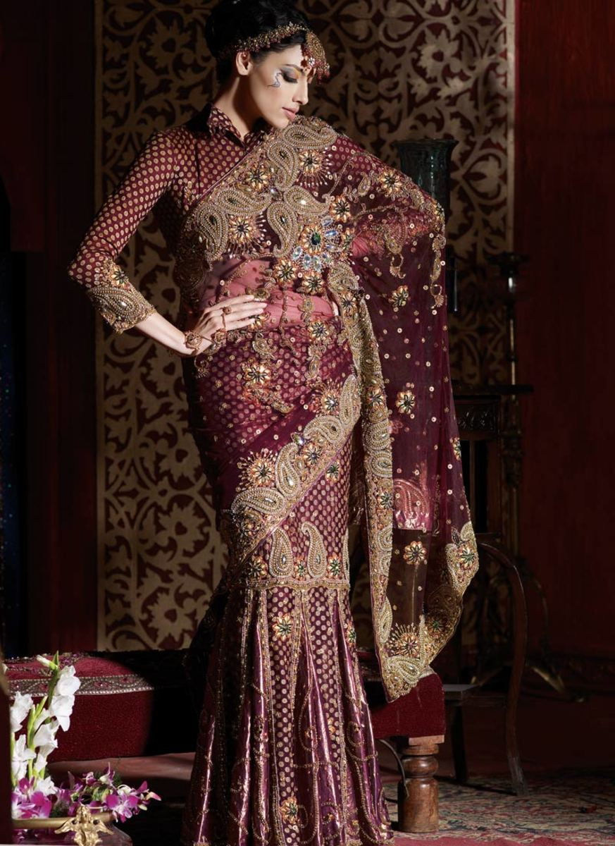 Full sleeve maroon blouse with bridal heavy design saree