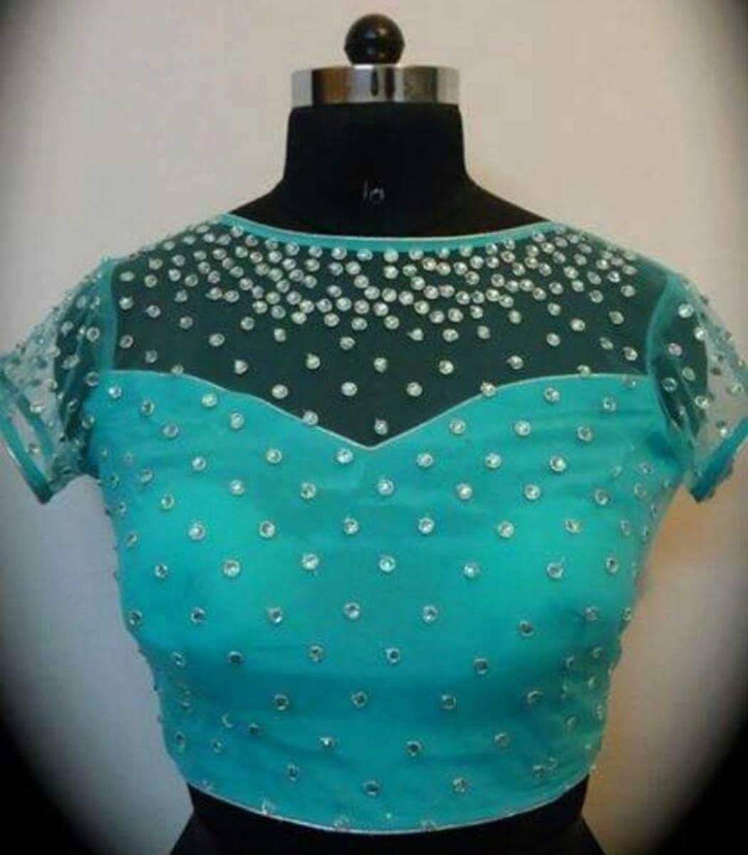 aqua blue blouse with sheer shoulders