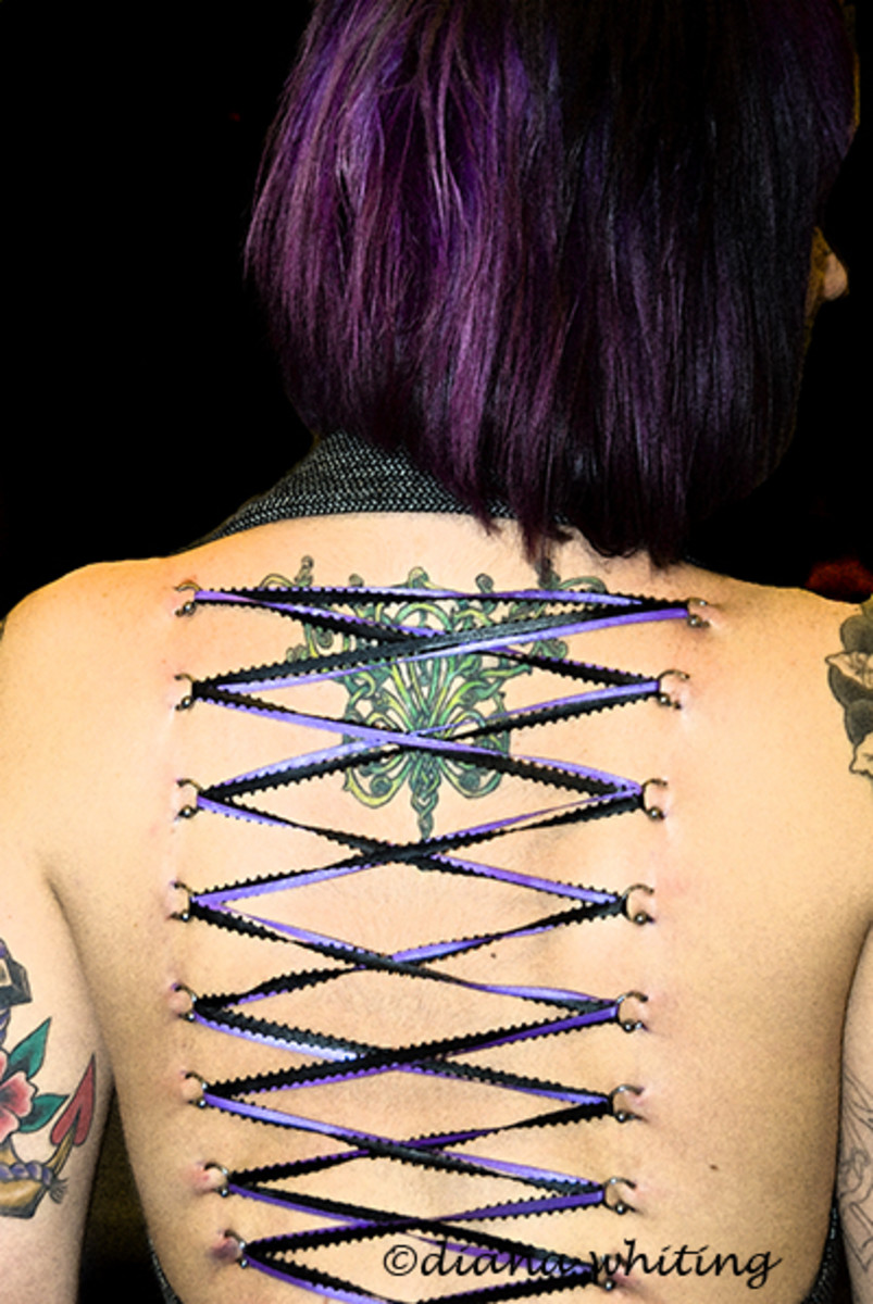 tattoo and corset piercing