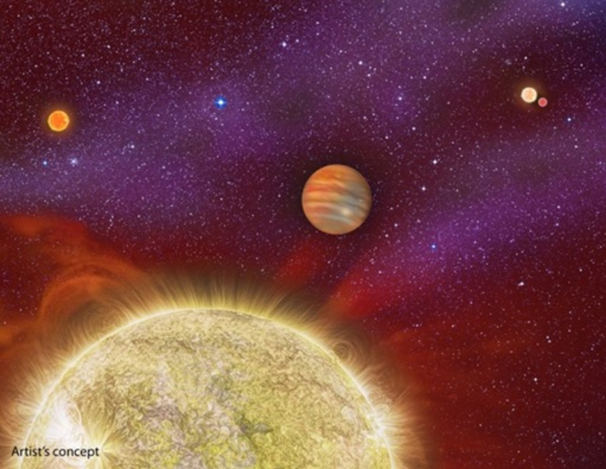 "This artist's conception shows the 30 Ari system, which includes four stars and a planet. The planet, a gas giant, orbits its primary star (yellow) in about a year's time. The primary star, called 30 Ari B, has a companion -- the small ""red dwarf"" st"