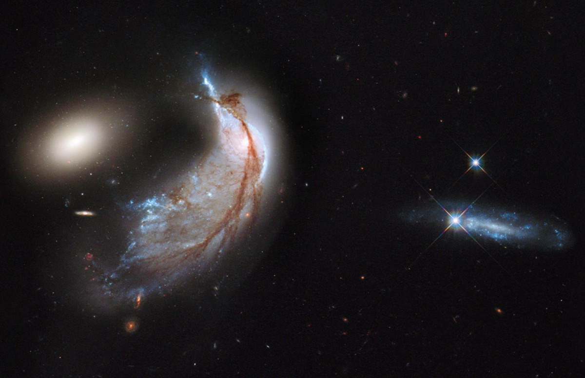 This interacting galaxy duo is collectively called Arp 142. The pair contains the disturbed, star-forming spiral galaxy NGC 2936, along with its elliptical companion, NGC 2937 at left. Once part of a flat, spiral disk, the orbits of the galaxy's star