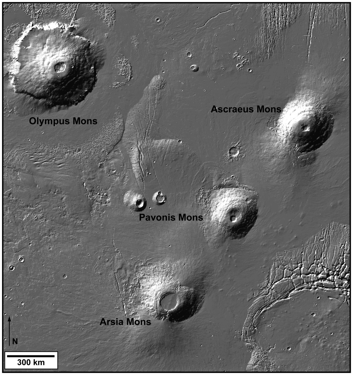 Shaded relief image derived from Mars Orbiter Laser Altimeter data, which flew onboard the Mars Global Surveyor-Image shows Olympus Mons and the three Tharsis Montes volcanoes . Photo credit NASA