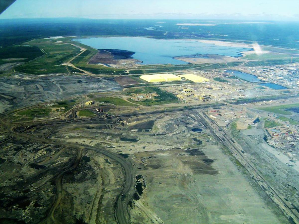 Aerial view of Syncrude's Mildred Lake Plant, Alberta Oil Sands.  The Oil Sands are Canada's beggest emitters of greenhouse gases.  Image courtesy of Wikipedia.