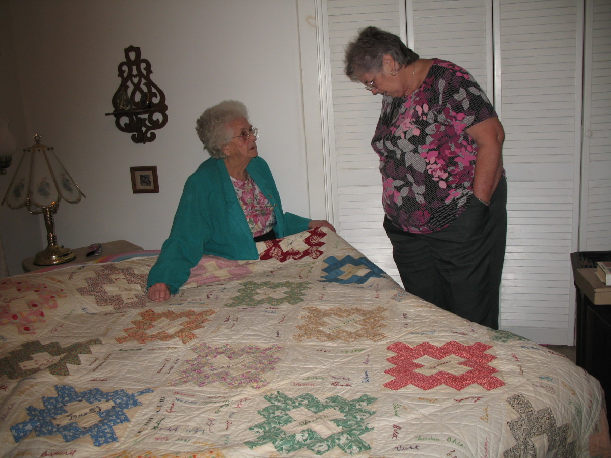 The colored sections of the quilt are made with printed 1930s fabrics.