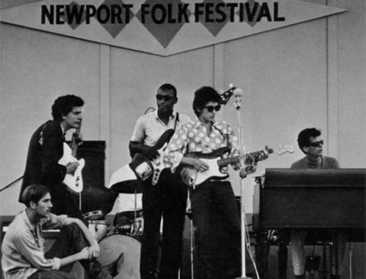 Kooper (at right) plays with Bob Dylan at the Newport Folk Festival in 1965.