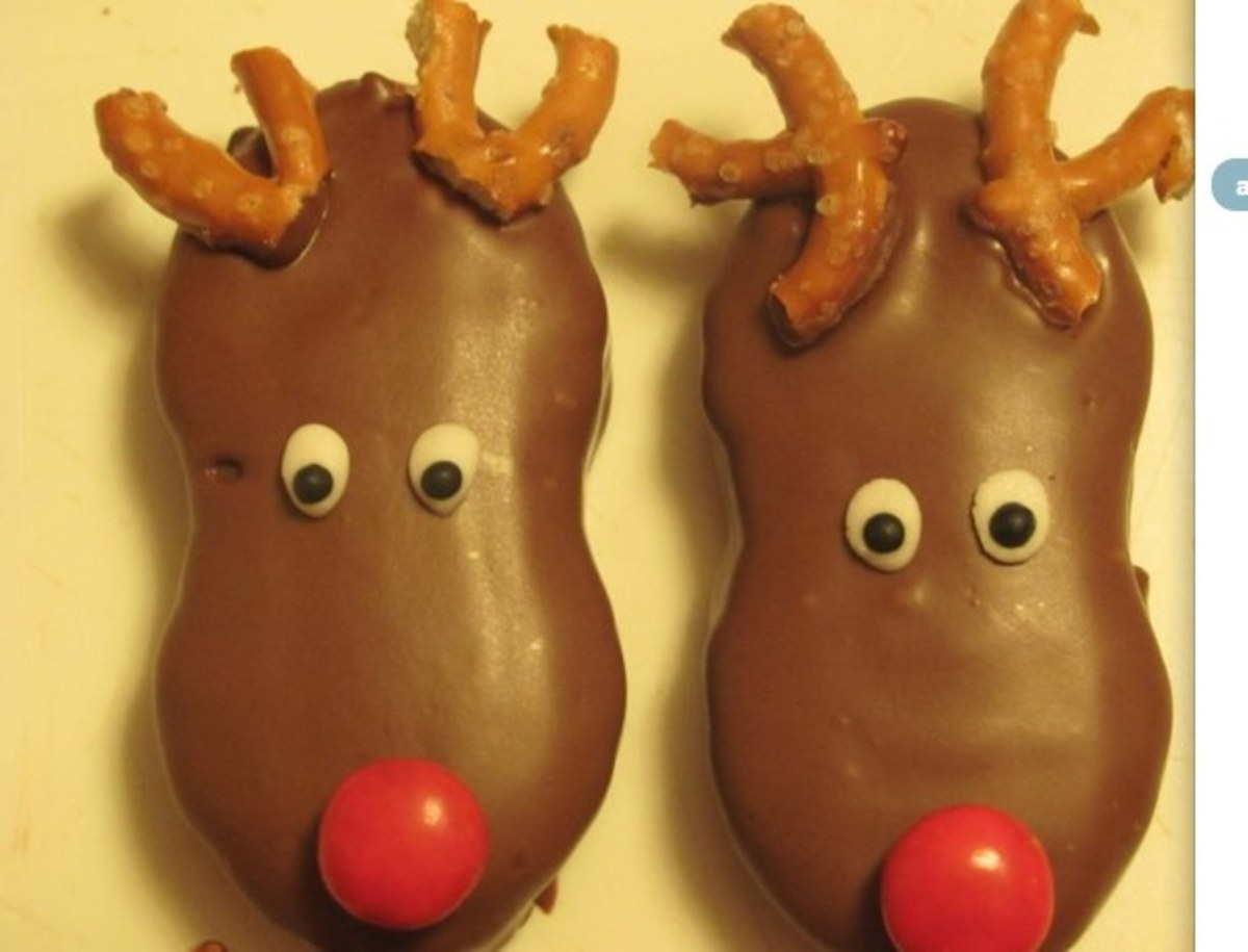 Nutter Butter reindeer cookies dipped in chocolate. Pretzel antlers.
