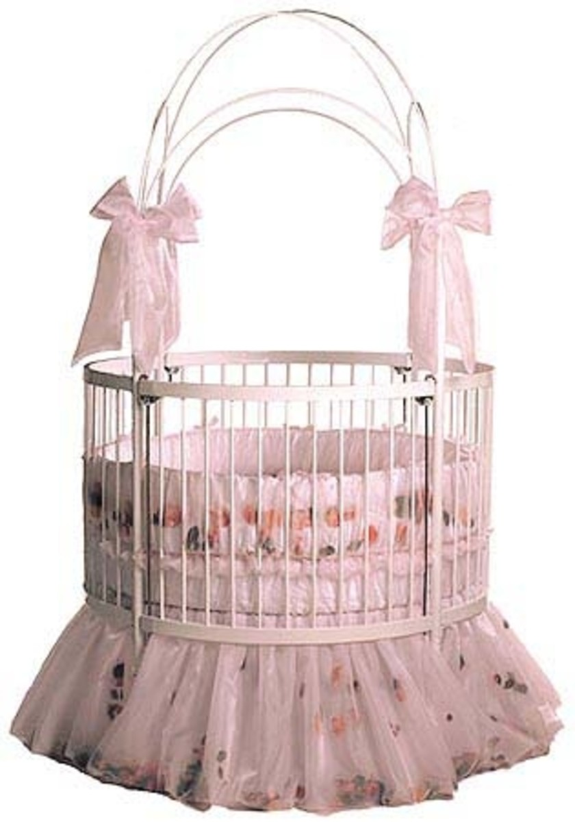 "This beautiful round-baby-crib, From the ""Little Miss Liberty"" Collection.  The Bedding is Little Miss Liberty's ""Enchanted Forest Universal Canopy Set"""