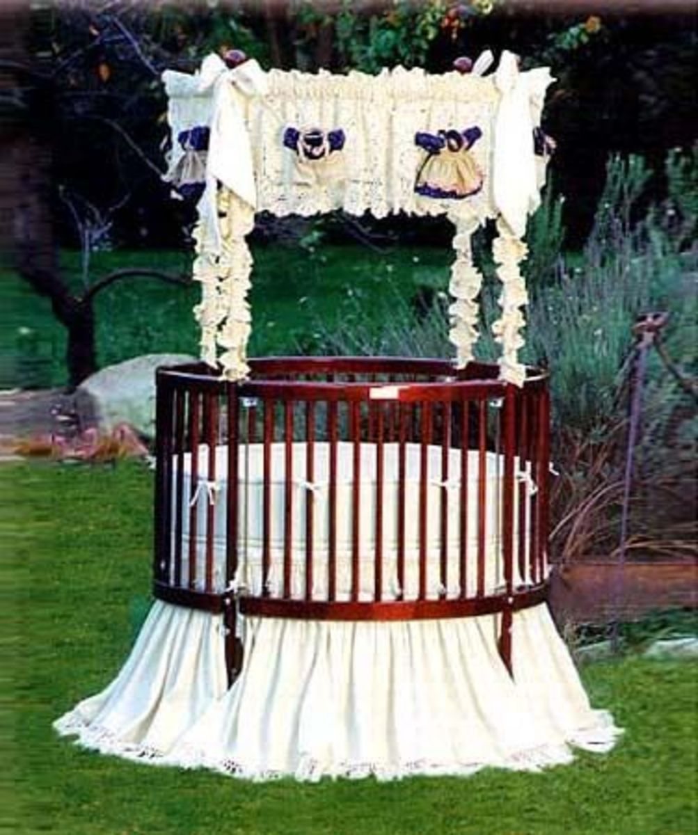 "This beautiful round-baby-crib, From the ""Little Miss Liberty"" Collection.  The bedding is ""Nana's Heirloom Universal Canopy Set""."
