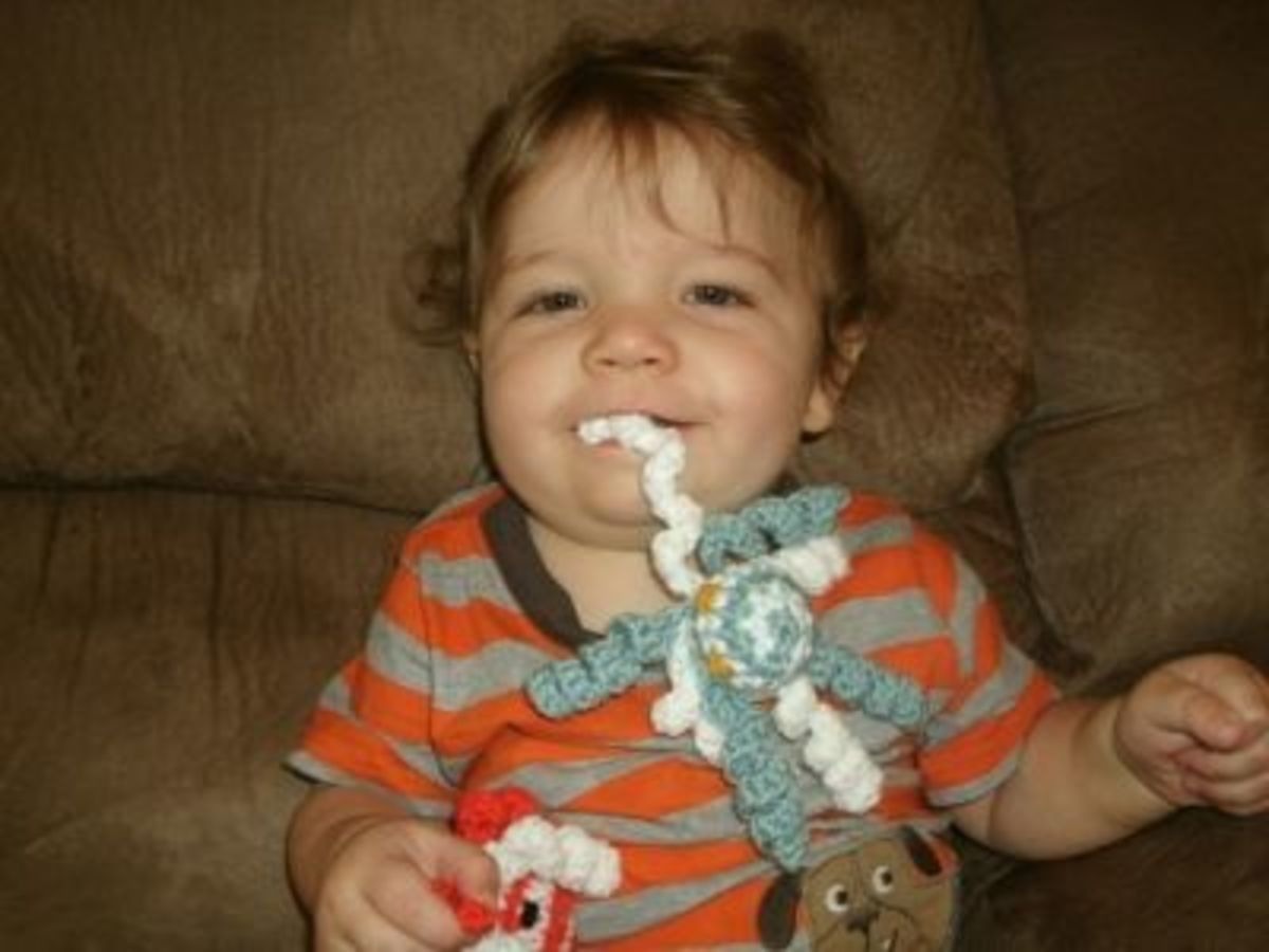 Baby Josiah thinks his crocheted octopus is a 'teething toy'!