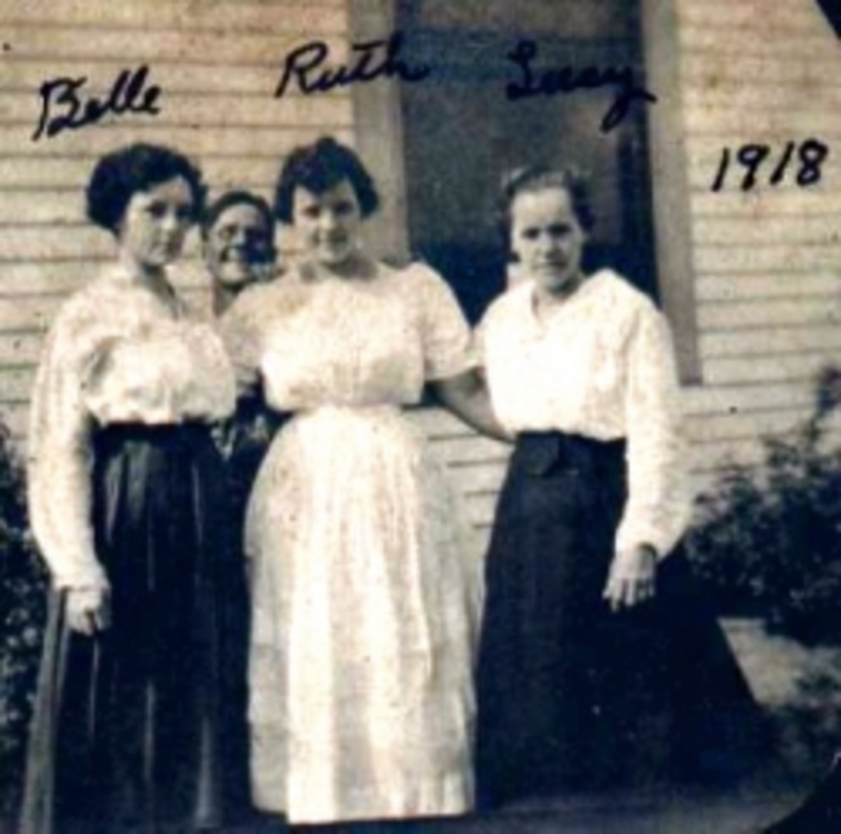 A 1918 photo of my grandmother, Ruth Vining with her sisters in Tyro, Kansas. Not sure who that fellow is behind them. It might be their brother Albert.