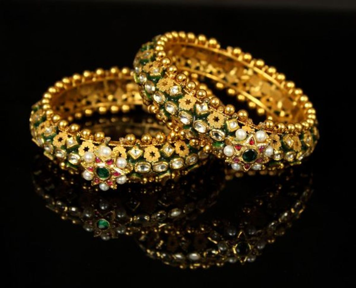 Regal kundan and meena painted thick gold bangles perfect for a new bride