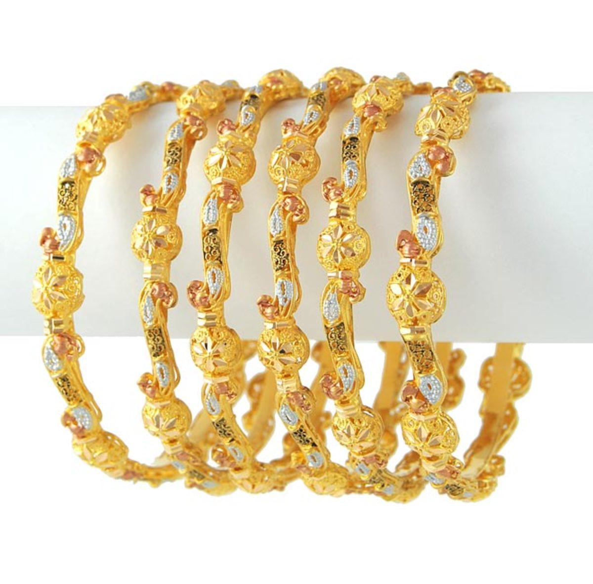 Half a dozen gold bangles