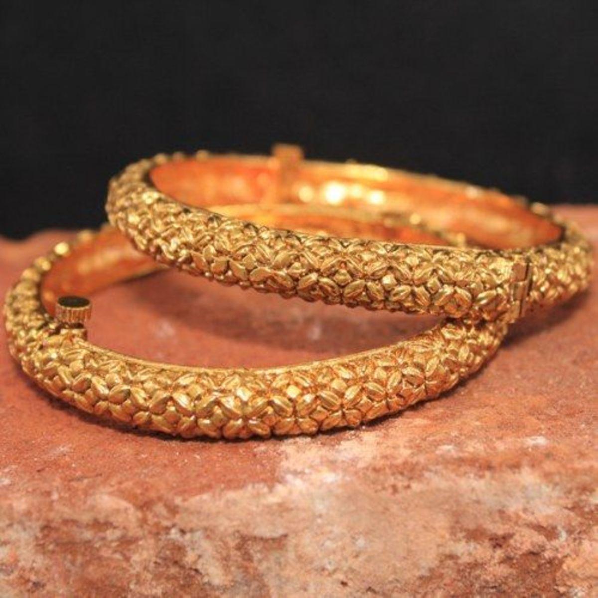 Plain gold designer bangle with hinge opening