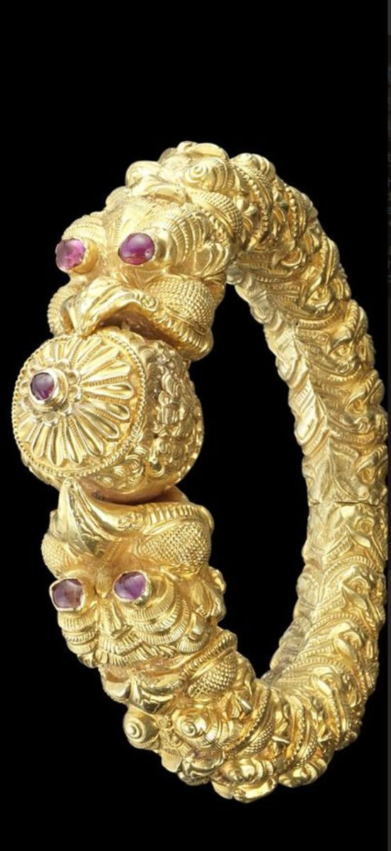 traditional gold bangle design with red stone