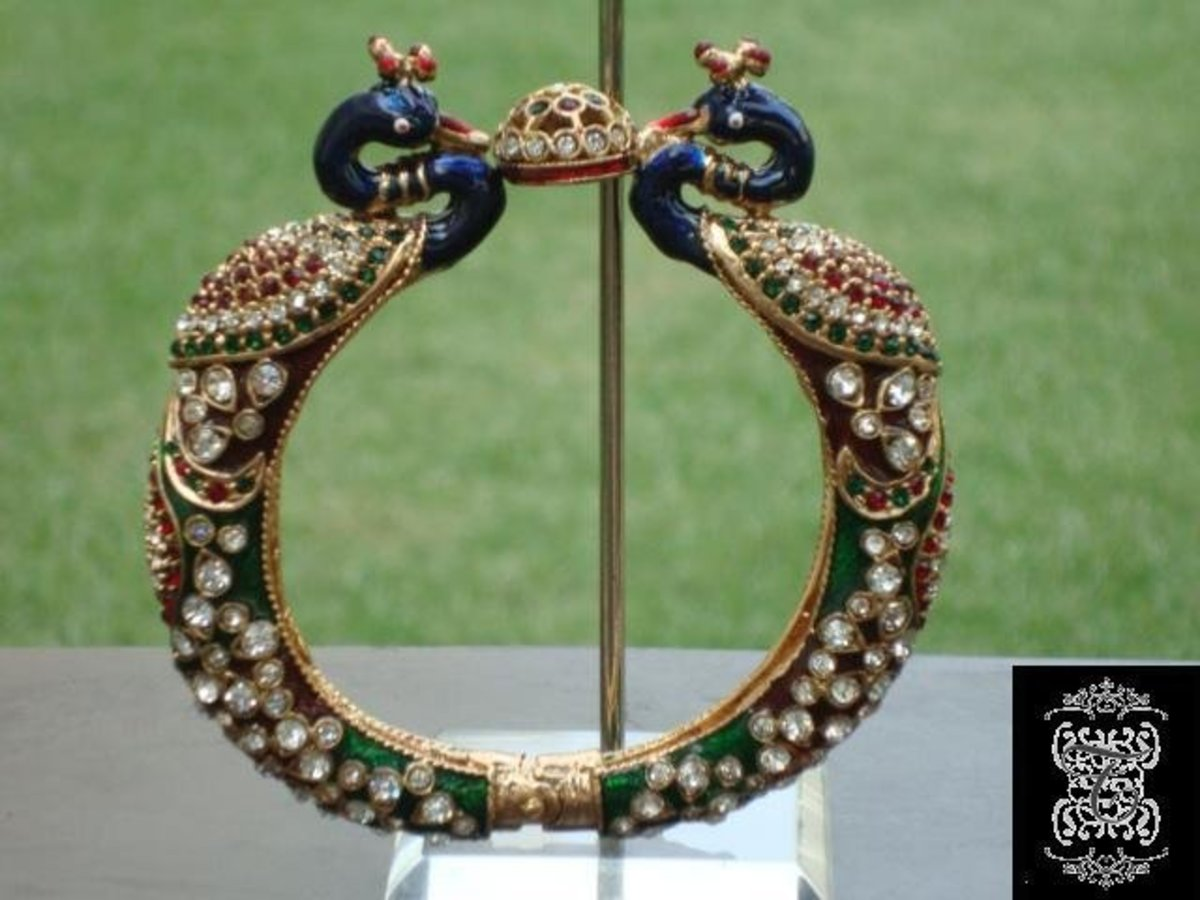 Peacock and Mina gold bangle