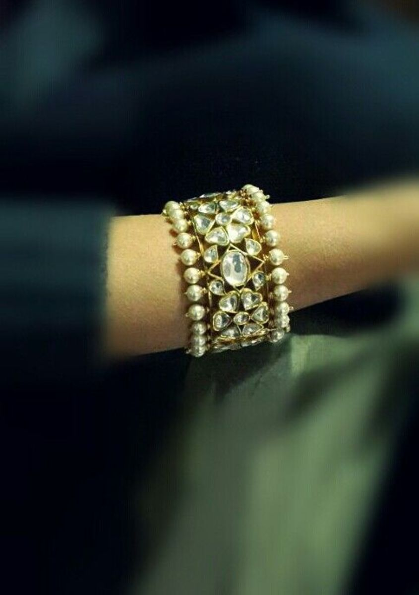 Thick pearl and white kundan one hand bangle
