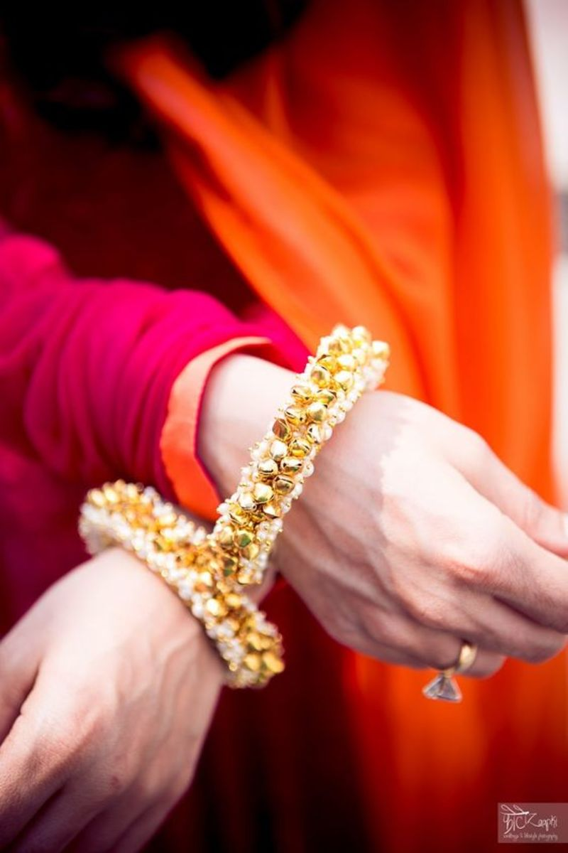 small pearl puthi and gold bangle pair