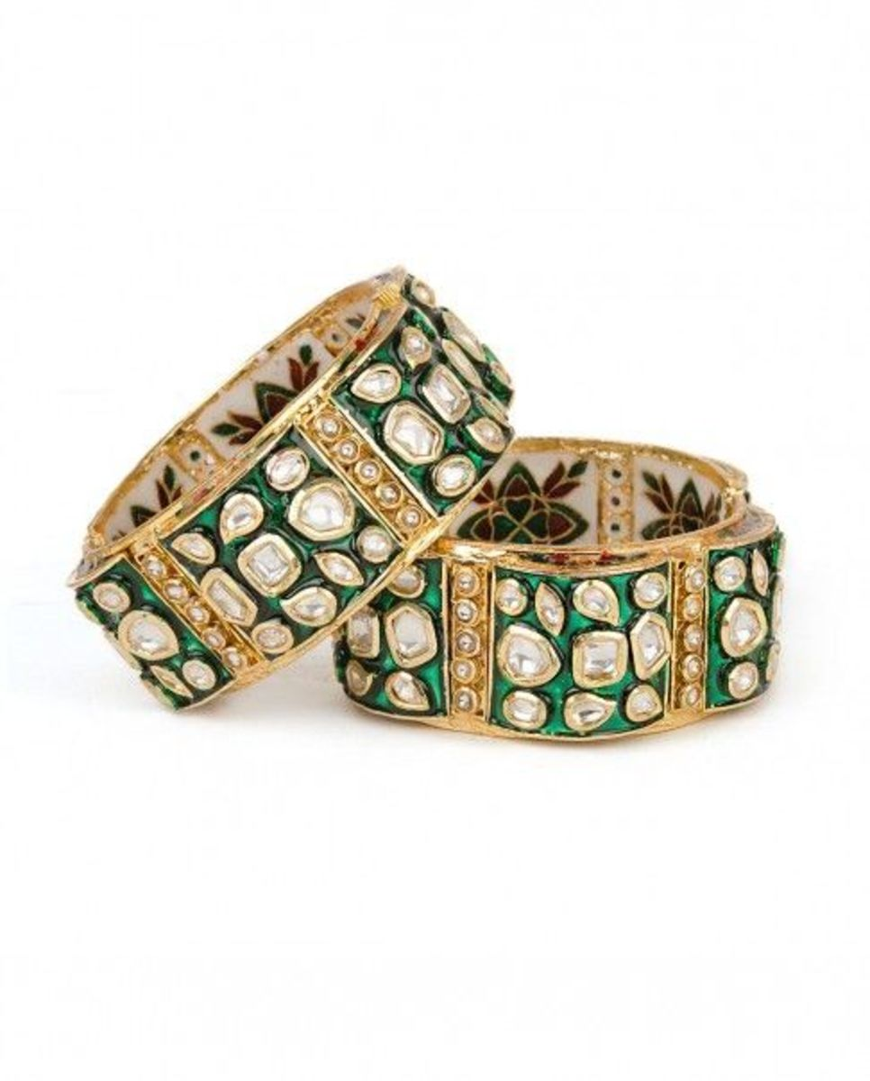 Gorgeous jaipuri design gold bangles with kundan and green meena painting on the outside and maroon and white floral meenakari inside the bangle