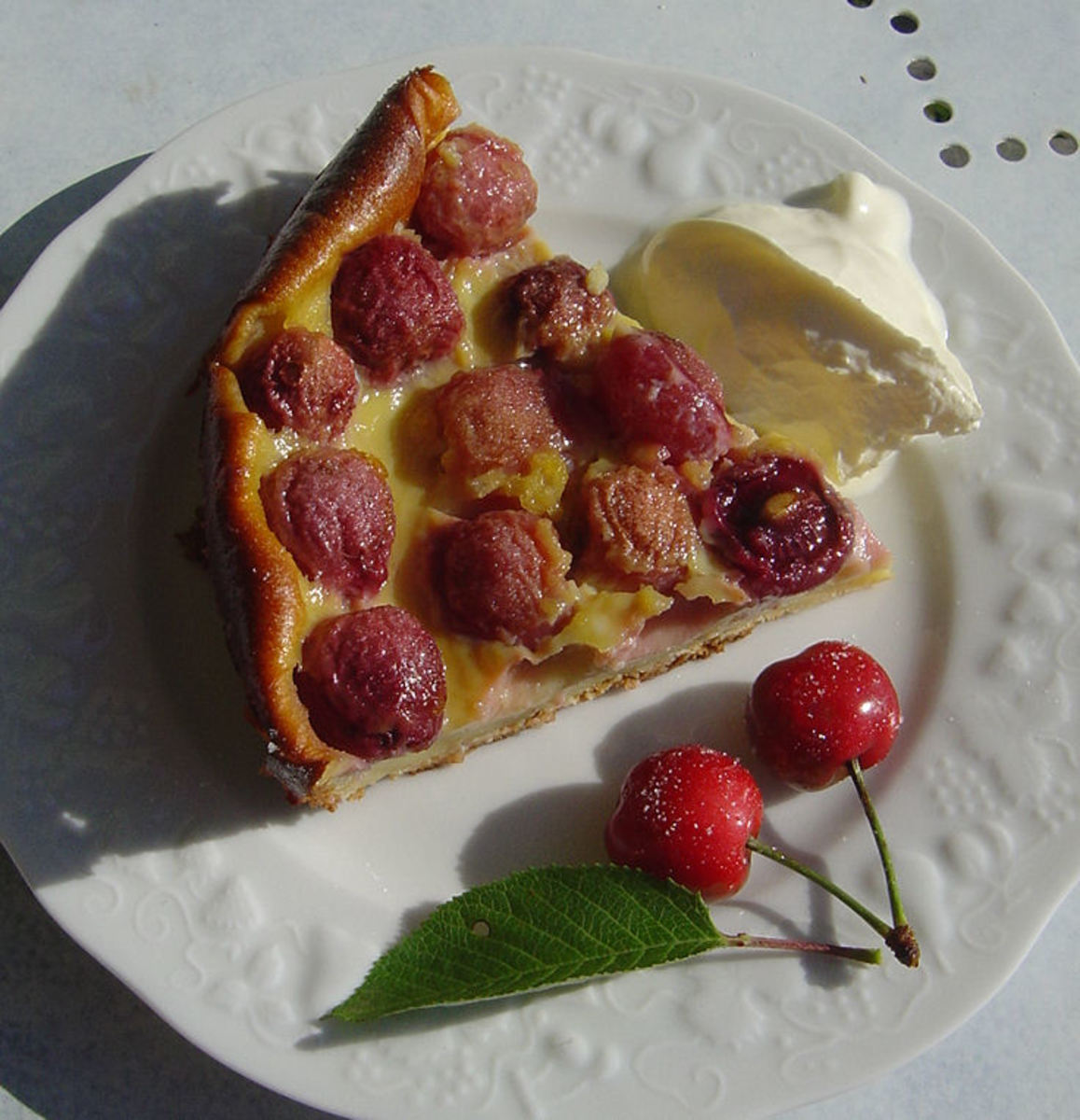 Cherry Clafouti, delicious hot or cold and served with creme fraiche and a couple of fresh cherries
