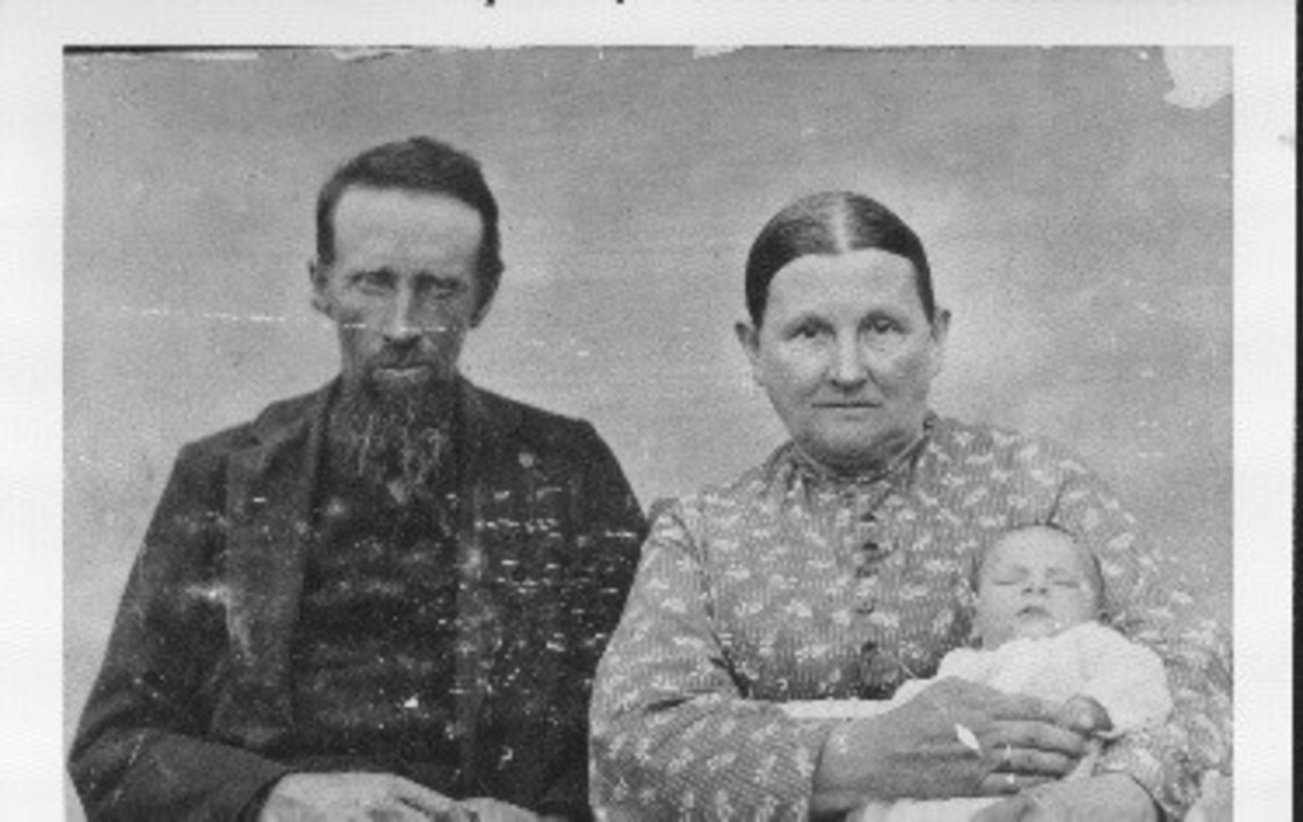 An emaciated Abraham Tower with his wife, Nancy, and a grandchild.