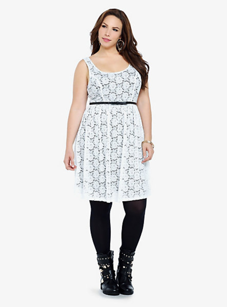 cutout lace overlaying a black lining, this dress is a girly example of fall's high contrast monochromatic trend. Includes skinny black bow belt.
