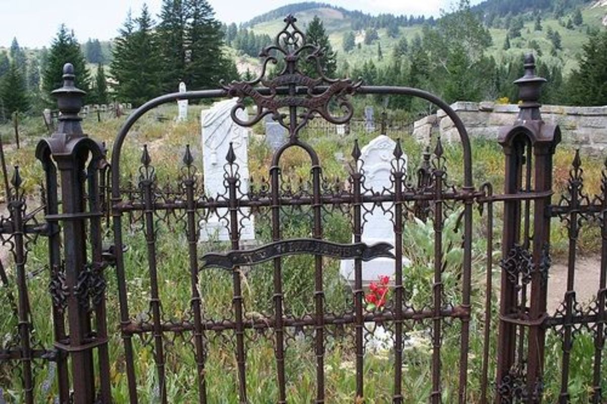 I absolutely love the old rusted and well patina'd rod iron fences and gates in the cemetery. They are just built with such character, ornate and beautiful they only get better with age. This fence says: PAT Champion Iron Fence Co Kenton Ohio W.V