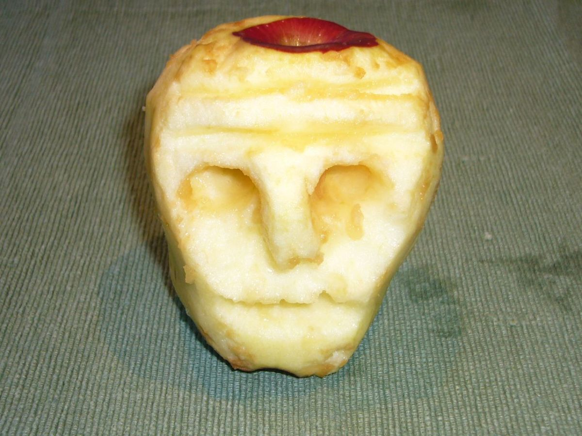 A Face Carved in an Apple