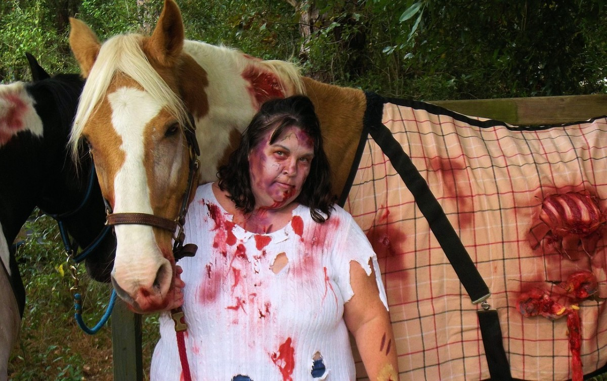 Use clothing and a horse blanket that you don't mind messing up. Use plenty of gory blood (available at stores in October wherever costumes are sold)