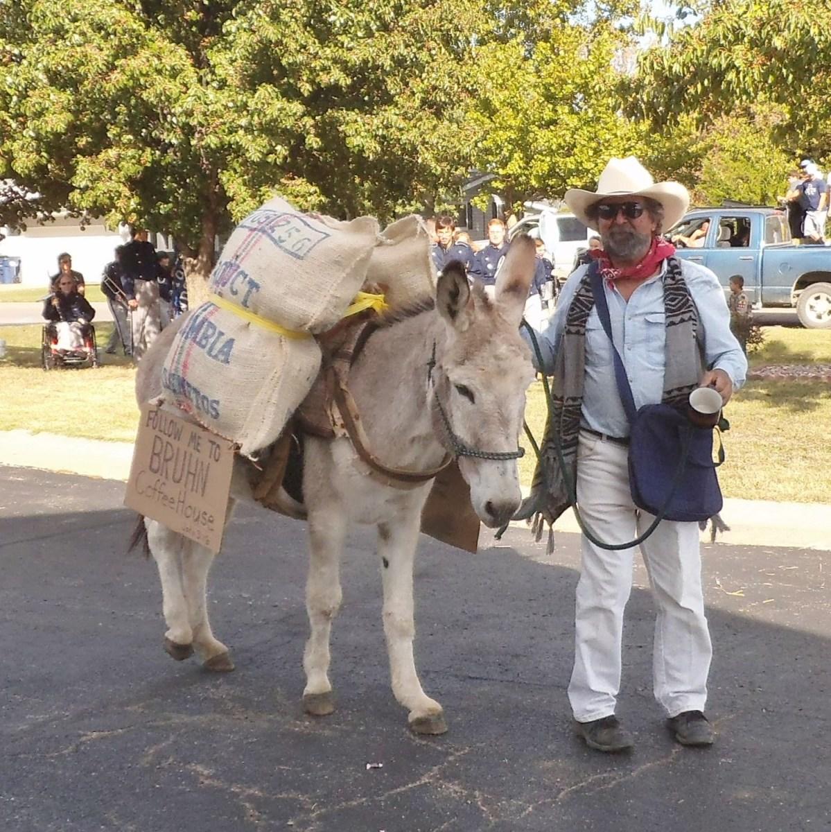 Juan Valdez with his burro and sacks of coffee