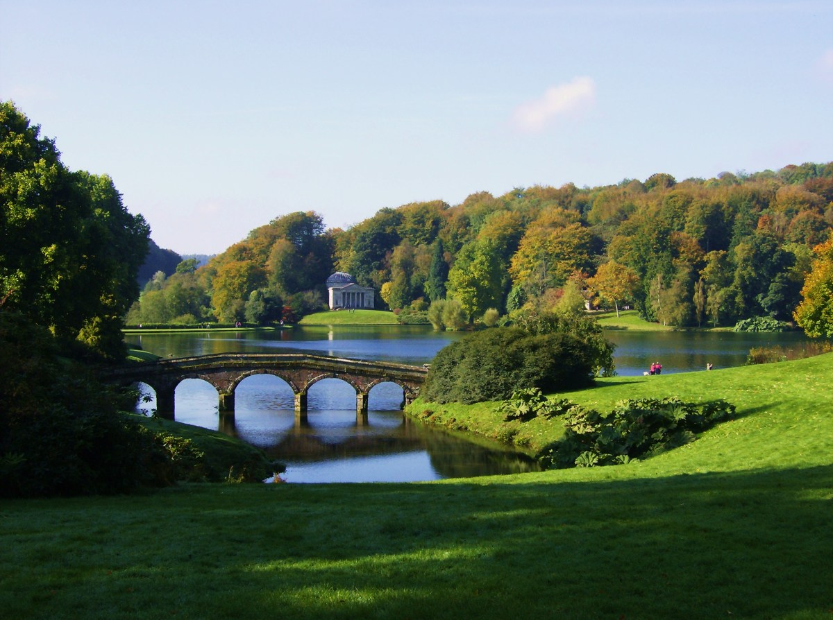 View across the lake at Stourhead towards the temple of Apollo.