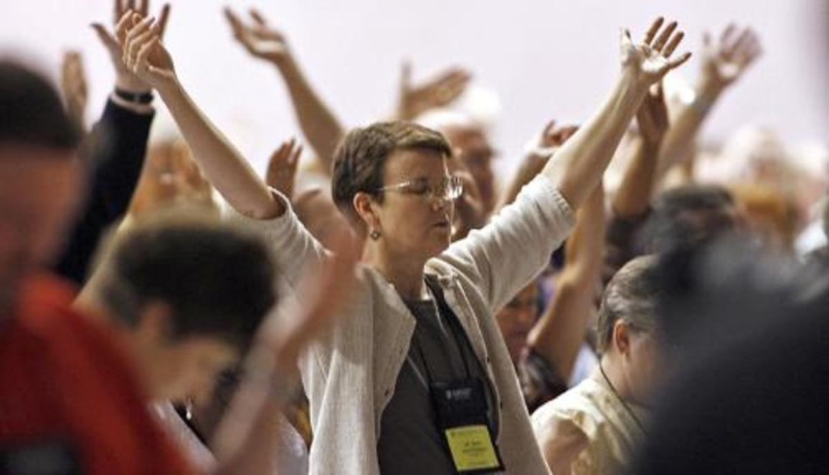 ELCA members pray for guidance during their 2009 Convention in Minneapolis, Minnesota. Photo by: Marlin Levison, Star Tribune