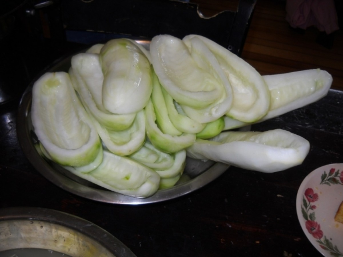 Cut the Cucumbers into Boats or Canoes to Make Pickles