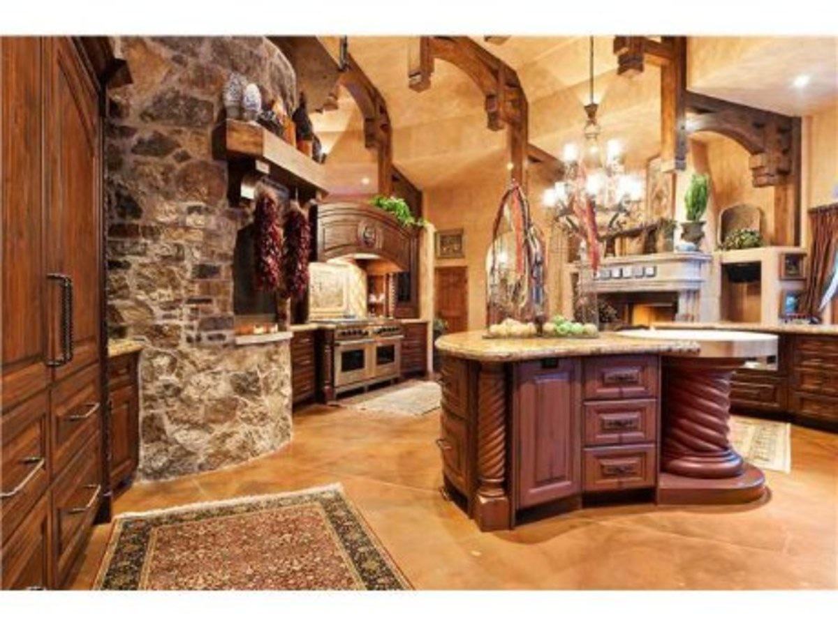 wood beams accentuate a vaulted kitchen ceiling